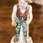 Antique old man figurine