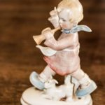Antique knick-knackery figure, little child